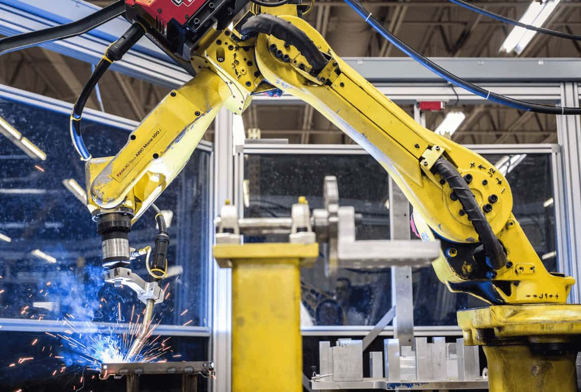 A robot working with low-volume metal fabrication suppliers