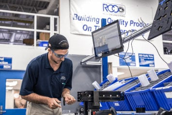 A worker at RCO aerospace assembles a seat in our manufacturing facility made by aerospace manufacturing services