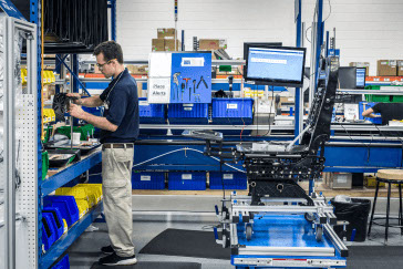 A worker assembles seats in RCO aerospaces production manufacturing facility.