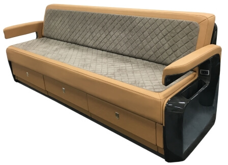 A custom divan for a business jet made by aerospace manufacturing services