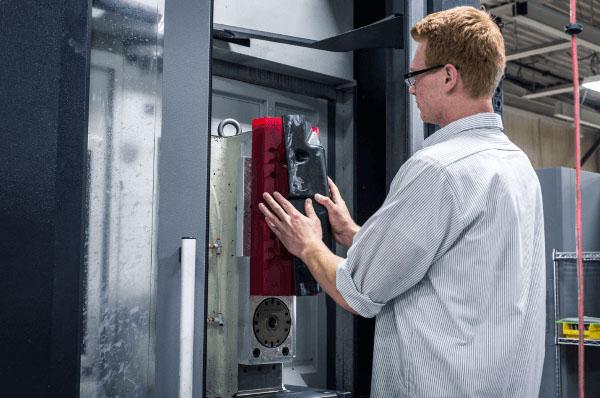 A man beginning a compression molding