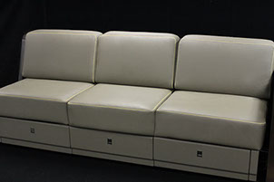 A leather appointed aerospace Divan made by aerospace manufacturing services