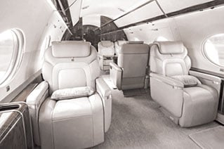 A high end business jet interior with leather appointed seats.
