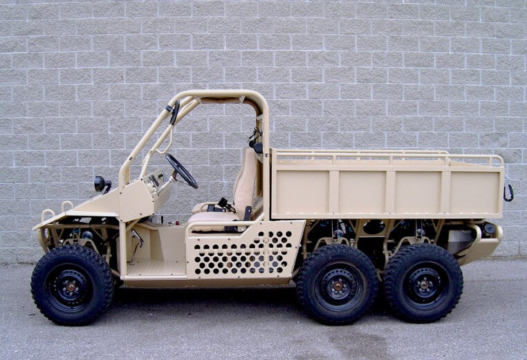 A prototype military vehicle on the road.