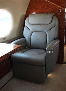 A leather appointed aerospace seat for a business jet made by aerospace manufacturing services
