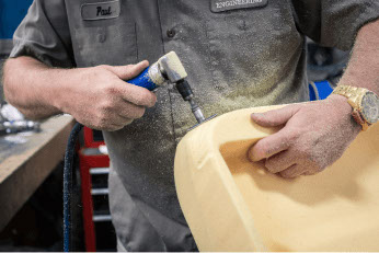 A man handworking prototype foam