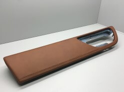 A leather trimmed automotive door panel sits on the shelf automotive manufacturing services