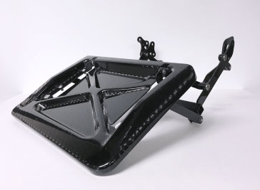 A carbon fiber footrest assembly for an aerospace seat made by aerospace manufacturing services