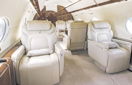 Interior of a business jet appointed in leather made by aerospace manufacturing services
